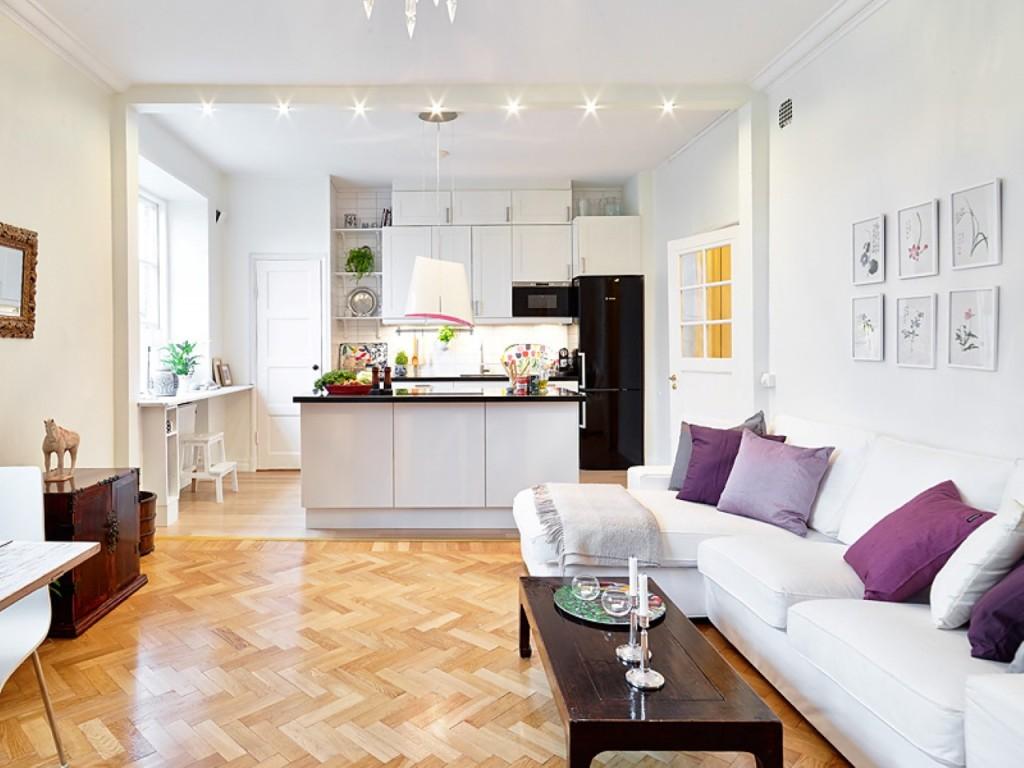 зонирование кухни-гостиной с помощью паркета и освещения