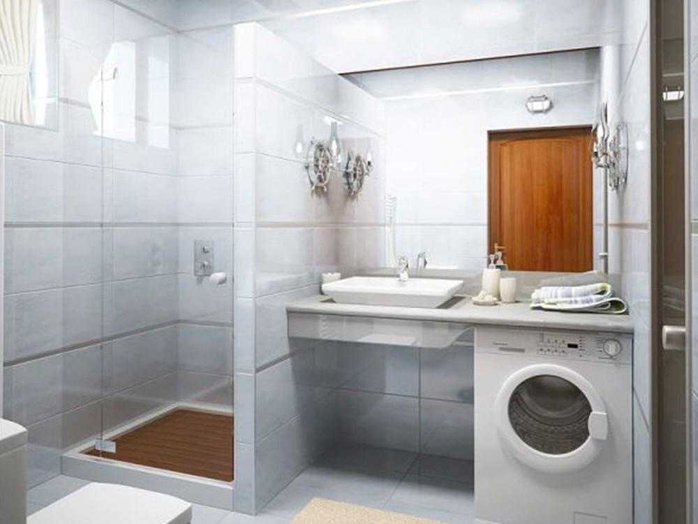 ванная комната с душевой кабинкой и стиральной машиной